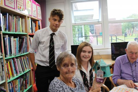 Residents Mary Clewes and Edward Oakley with pupils Oliver Marquis-Johnson and Lily Benton.