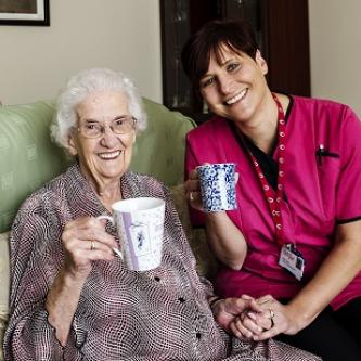 Carer Sally Rutty (on the right) providing care in the home